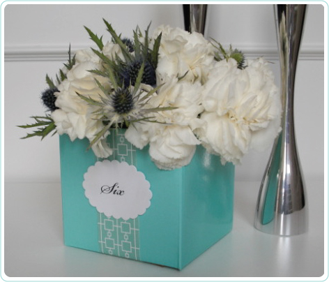 """4"""" cube in aqua marine used as the table number holder"""
