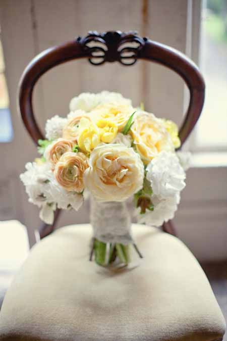 bridal bouquet with yellow garden roses and peach ranunculus white garden roses