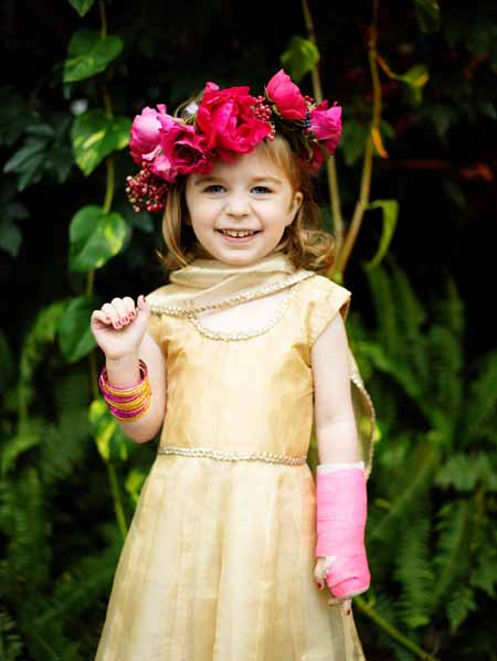 Flower girl with a halo of hot pink garden roses