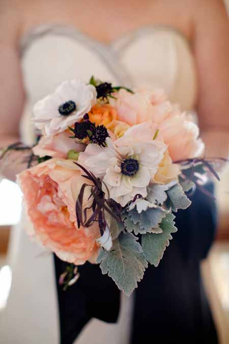 Bridal bouquet of anemones garden roes and dusty miller designed by Sullivan Owen