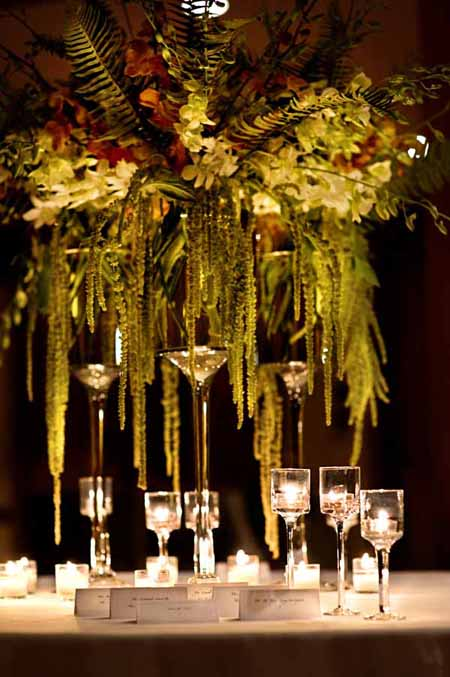 green hanging amaranthus and orchid centerpiece