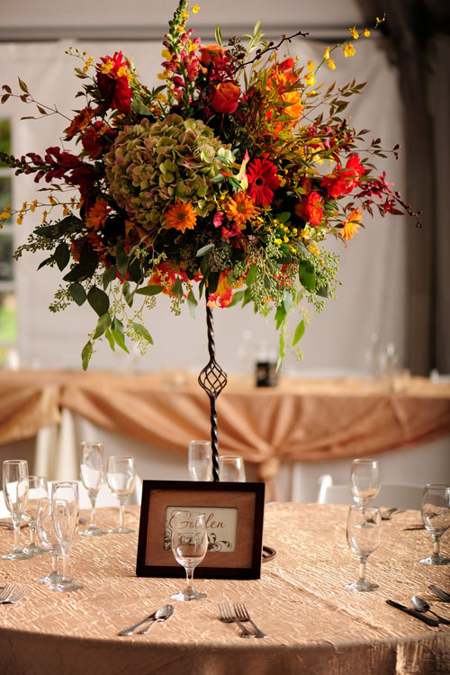 Elevated flower centerpiece using fall colors
