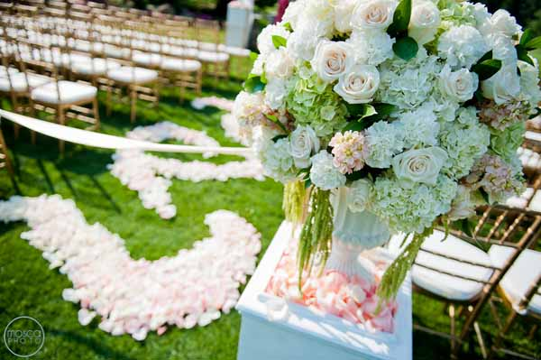 ceremony flowers in garden urns