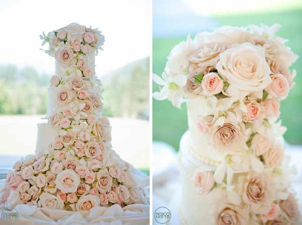 wedding cake decorated with roses and orchids