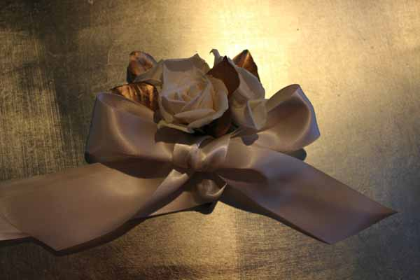 tie the bow on a wristlet corsage