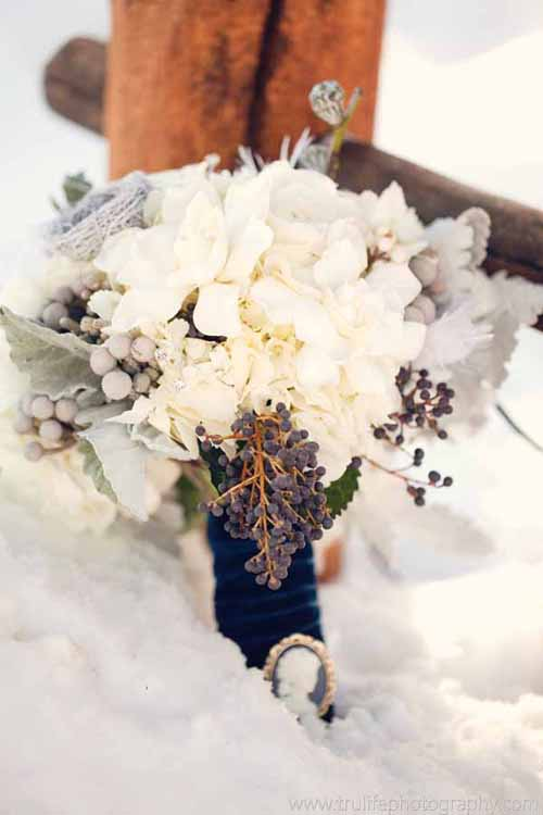 Bridal bouquet with blue privet berries dusty miller and white flowers