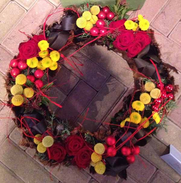 red and yellow flower wreath