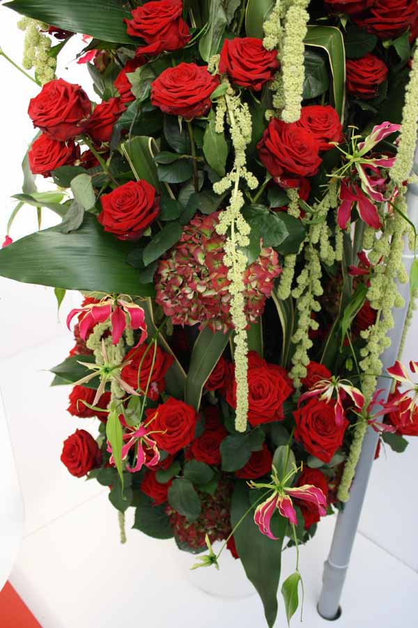 red roses, hydrangea, amaranthus and gloriosa lilies