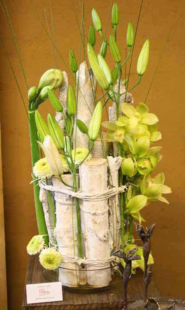 birch branch with green flower arrangement