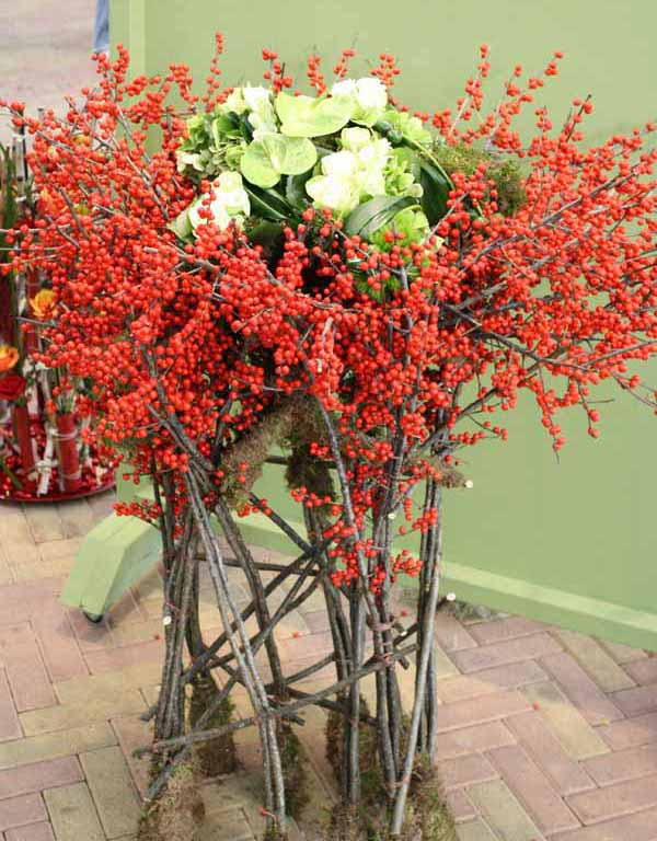 red ilex berries and green flowers