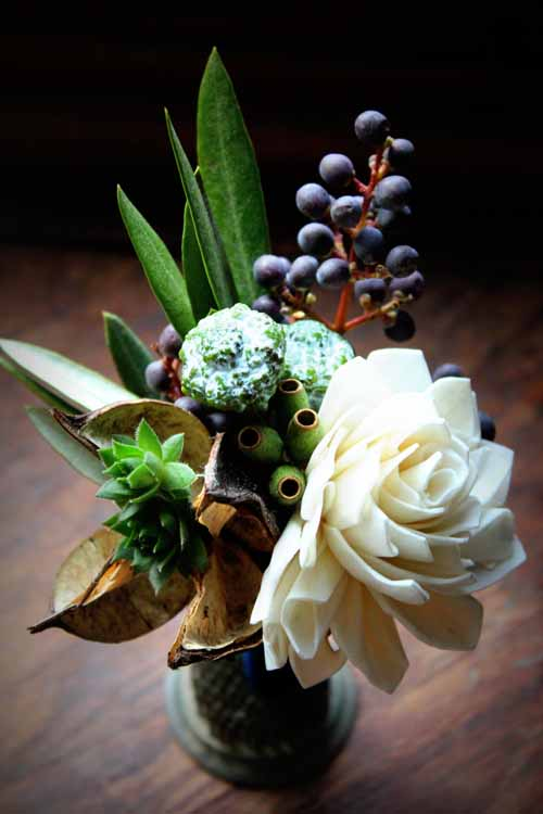 Boutonniere with berry and pod textures
